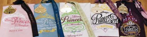 The past Princess Half-Marathon medals from runDisney