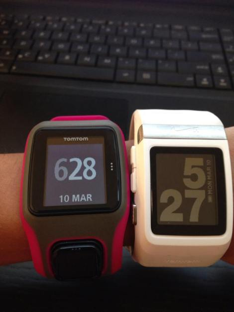 The watches face up.  (TomTom, left, and Nike+, right)