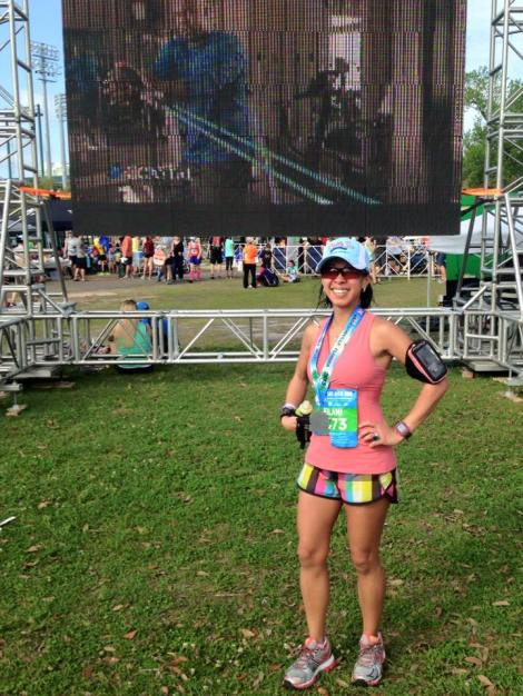 Posing in front of the Runners Village video wall